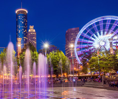 Picture of Fountain and ferris wheel in Atlanta, GA at nighttime
