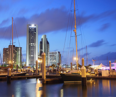 Picture of Sailboats in Bay with City Backdrop at Nighttime